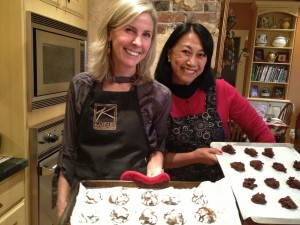 Girls putting in the oven 300x225 10 Tips for Hosting a Holiday Baking Day & Cookie Swap